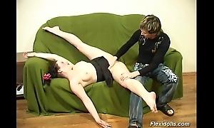 Flexible doll acquires dildo hard