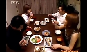 A Asian teenager is sitting in front dining table. Gifts from http://alljapanese.net