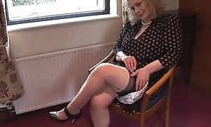 Huge boobs mature lady around slip and nylons