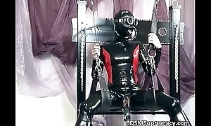 Nasty battle-axe in latex cloth palpate her