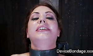 Sadomasochism babe arched back and kneeling on a Sybian