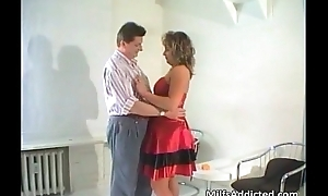 Brunette MILF blows hard cock and acquires