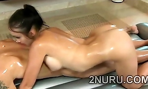 Busty Asian masseur gives erotic kneading with the brush hot body