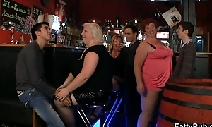 Crazy buxom chicks have fun in the bar