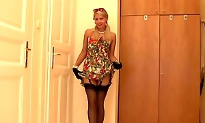 Mature kirmess  in sexy stockings plays to herself