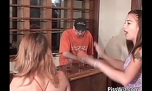 Young slutty babe pisses into a glass