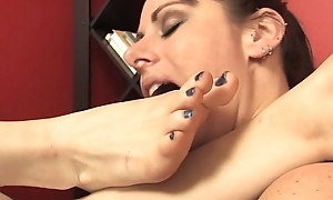lesbian reading a book while worshiping her foot