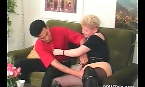 Chubby blonde milf close by long leather boots