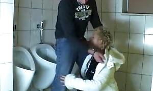 Beggar fucks a mature in a public bathroom