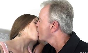 Sex-starved brunette pleasuring grey man on the sofa