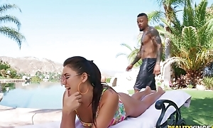 Young brunette pleasuring taking black guy by the pool