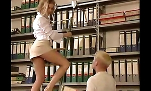 Titillating Librarian in Mini-Skirt - http:// /freemovies89